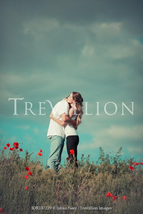 Ildiko Neer Young couple hugging in field