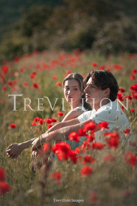 Ildiko Neer Young couple sitting in poppy field