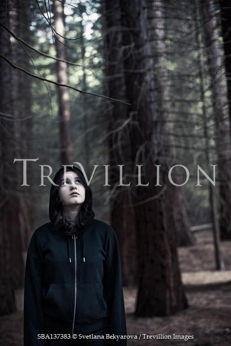 Svetlana Bekyarova YOUNG GIRL IN HOOD STANDING IN FOREST