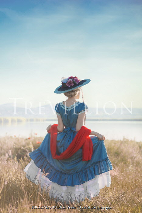 Ildiko Neer Historical woman walking by lake