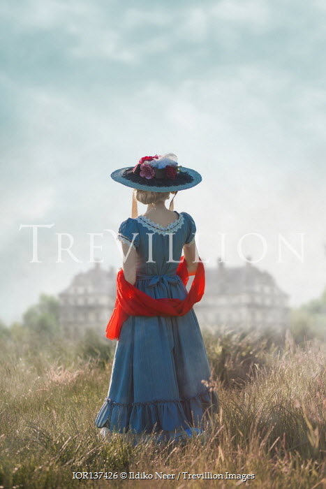 Ildiko Neer Historical woman standing in field by mansion