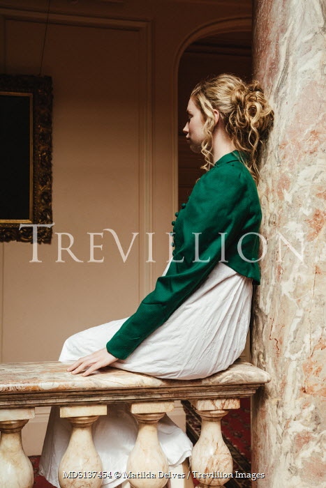 Matilda Delves HISTORICAL WOMAN SITTING BY MARBLE PILLAR INDOORS