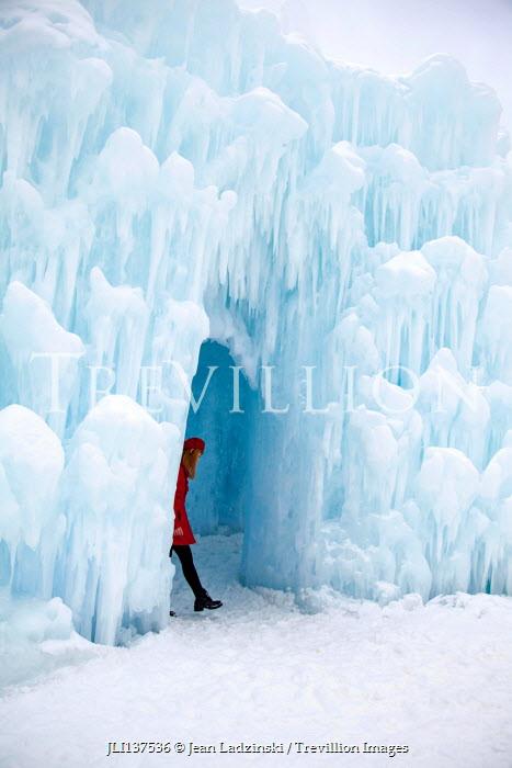 Jean Ladzinski GIRL WALKING INSIDE ICE CAVE