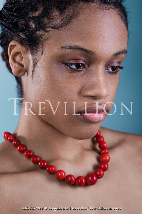Magdalena Russocka young african woman with red coral necklace inside