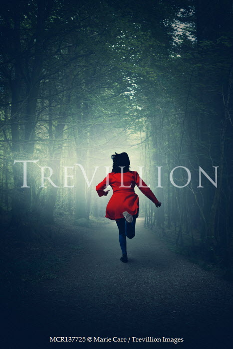 Marie Carr WOMAN IN RED COAT RUNNING ON FOREST PATH