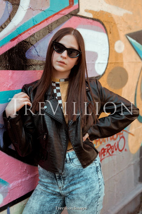 Greta Larosa YOUNG GIRL IN LEATHER JACKET AND SUNGLASSES OUTDOORS