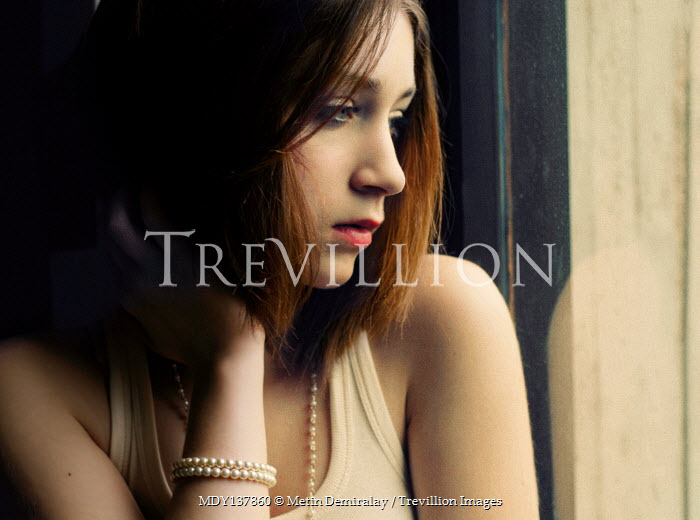 Metin Demiralay SERIOUS YOUNG GIRL WITH BROWN HAIR BY WINDOW