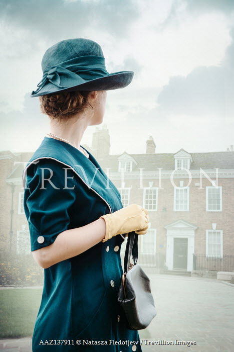 Natasza Fiedotjew Vintage woman with hat outdoors watching house