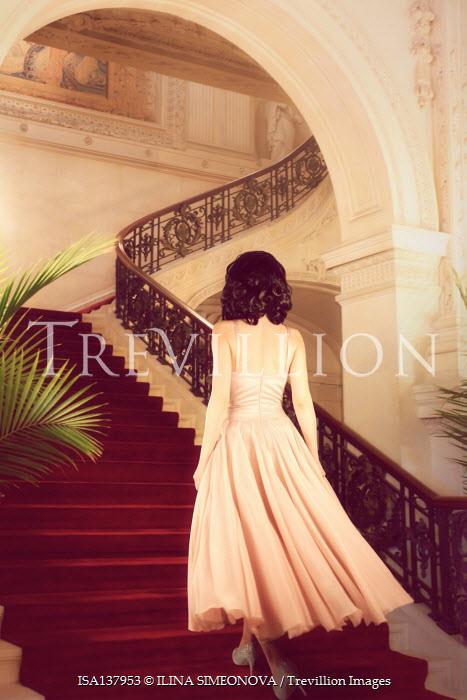 ILINA SIMEONOVA BRUNETTE WOMAN IN PINK GOWN CLIMBING GRAND STAIRCASE