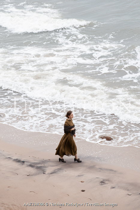 Natasza Fiedotjew Historical woman walking on beach by sea