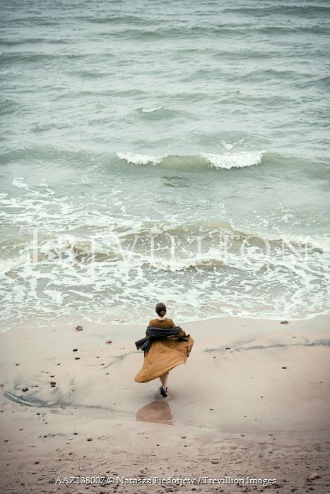 Natasza Fiedotjew Historical woman on sandy beach with waves