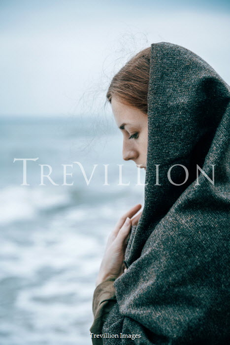 Natasza Fiedotjew Woman covered with woolen shawl standing by sea