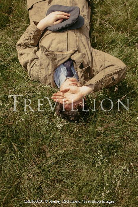 Shelley Richmond MAN LYING ON GRASS IN BOILER SUIT