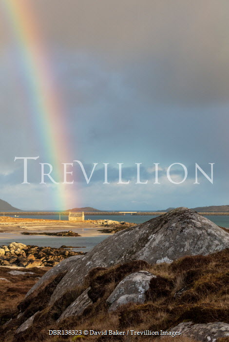 David Baker COTTAGE BY WATER WITH RAINBOW AND ROCKS