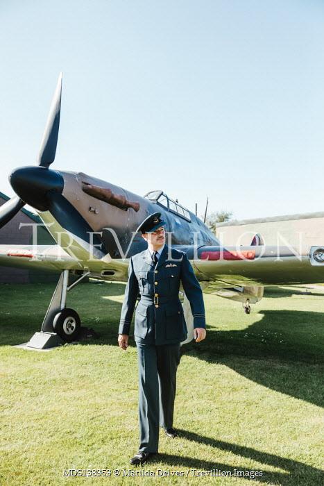 Matilda Delves WARTIME PILOT WALKING BY AEROPLANE