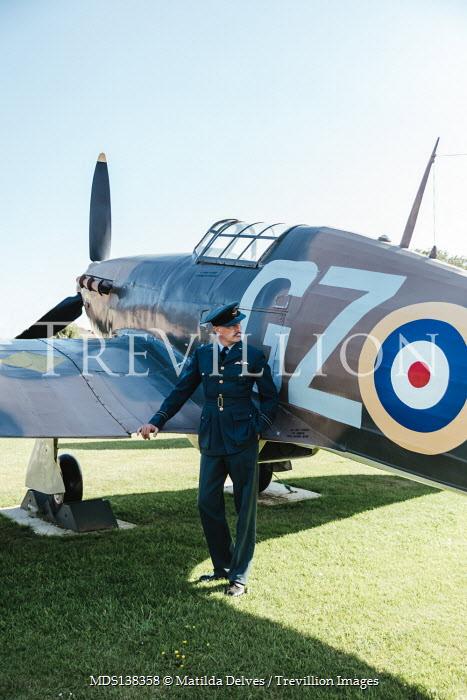 Matilda Delves WARTIME PILOT STANDING BY AEROPLANE ON GROUND