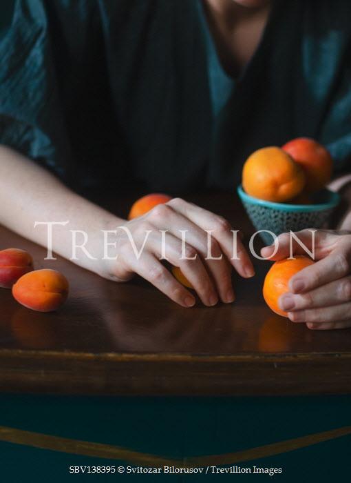 Svitozar Bilorusov FEMALE HANDS HOLDING ORANGES AND FRUIT