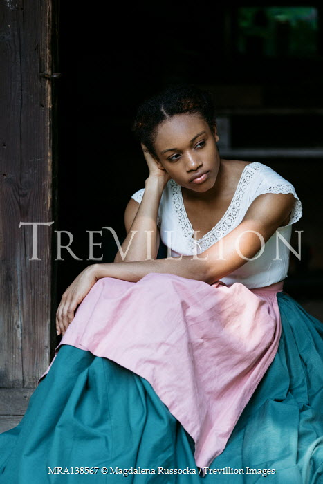 Magdalena Russocka historical african woman sitting on threshold of old cabin