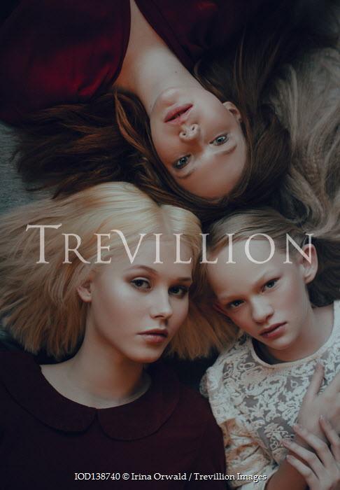 Irina Orwald THREE YOUNG GIRLS LYING ON FLOOR