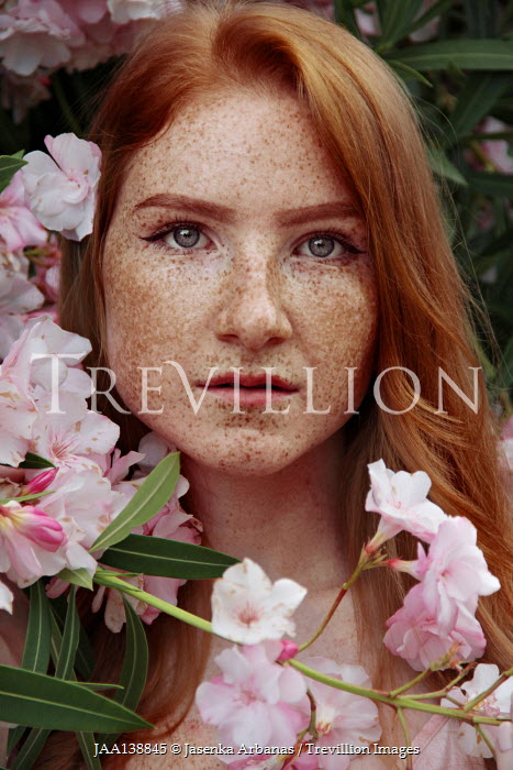 Jasenka Arbanas GIRL WITH RED HAIR AND FRECKLES OUTDOORS BY FLOWERS
