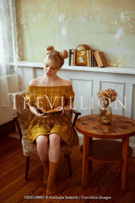 Nathalie Seiferth BLONDE WOMAN SITTING READING INDOORS