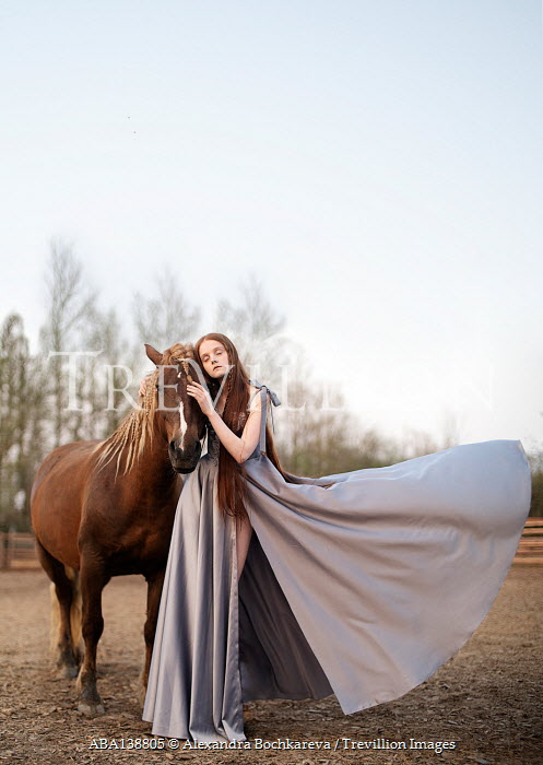 Alexandra Bochkareva DAYDREAMING WOMAN STANDING WITH HORSE OUTDOORS