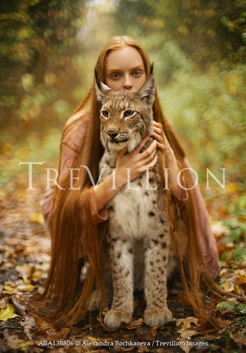 Alexandra Bochkareva GIRL SITTING HOLDING LARGE CAT OUTDOORS