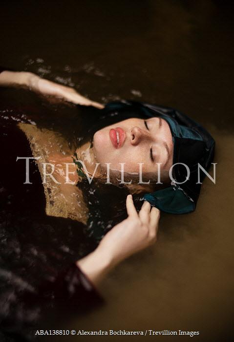 Alexandra Bochkareva WOMAN WITH CAPE FLOATING IN RIVER