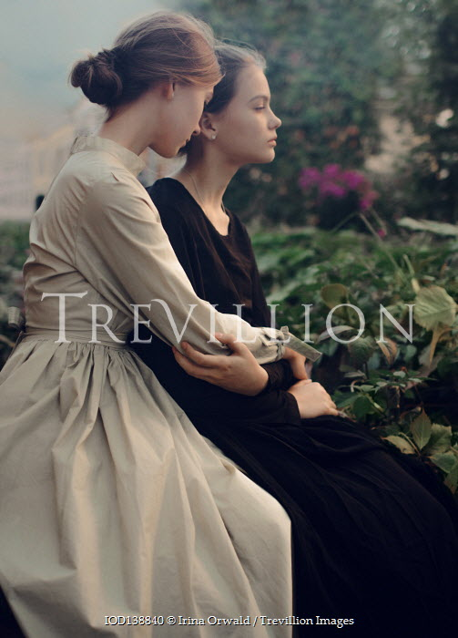Irina Orwald TWO SAD HISTORICAL GIRLS SITTING IN GARDEN