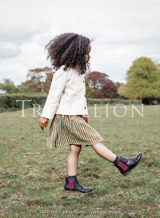 Eve North YOUNG GIRL IN BOOTS PLAYING IN FIELD