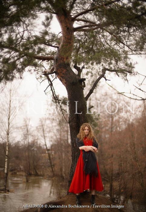 Alexandra Bochkareva WOMAN WITH SHAWL STANDING BY TREE AND RIVER