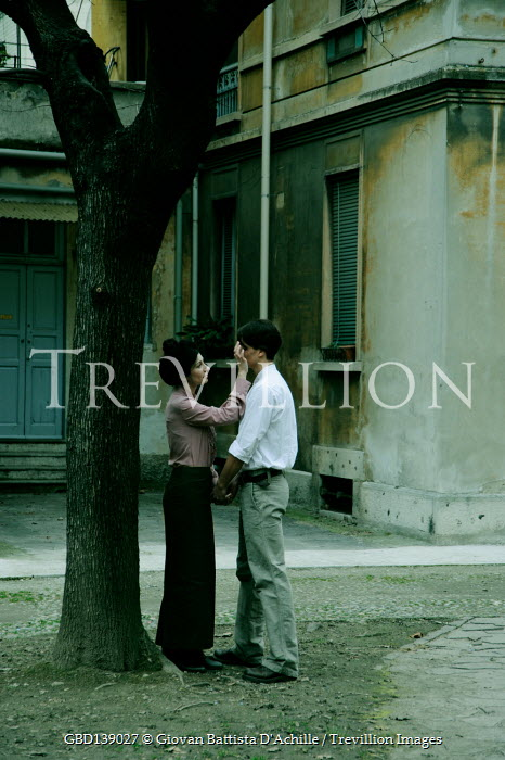 Giovan Battista D'Achille RETRO COUPLE IN STREET BY TREE AND BUILDING
