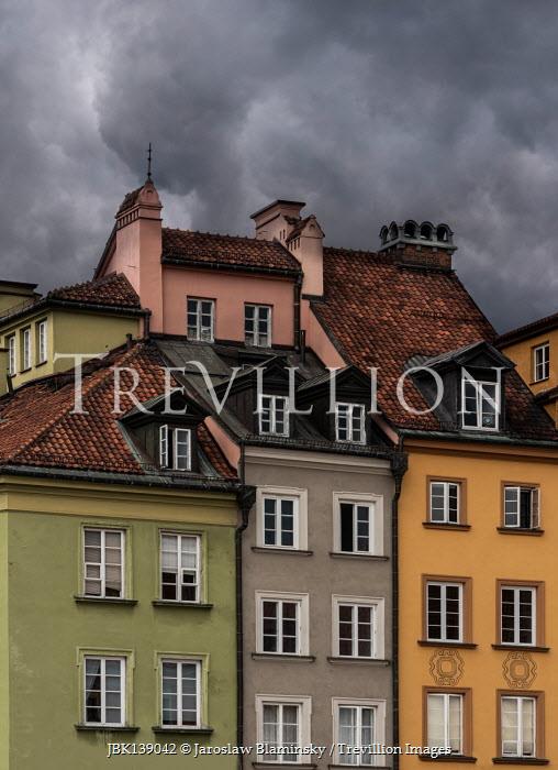 Jaroslaw Blaminsky MULTI-COLOURED HISTORICAL BUILDINGS WITH STORMY SKY