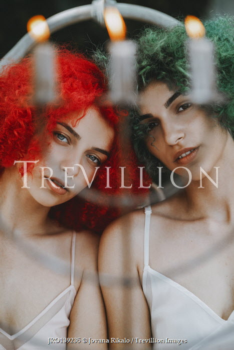 Jovana Rikalo TWO WOMEN WITH RED AND GREEN HAIR AND CANDLES