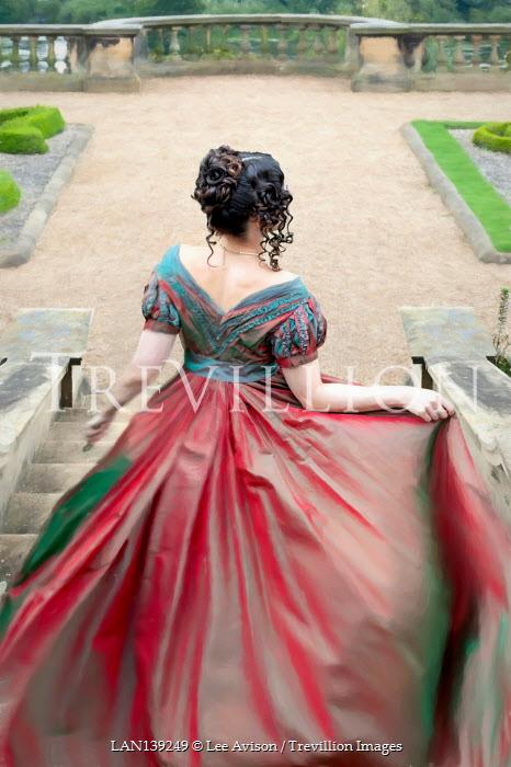 Lee Avison anonymous regency woman descending stone steps to a formal garden