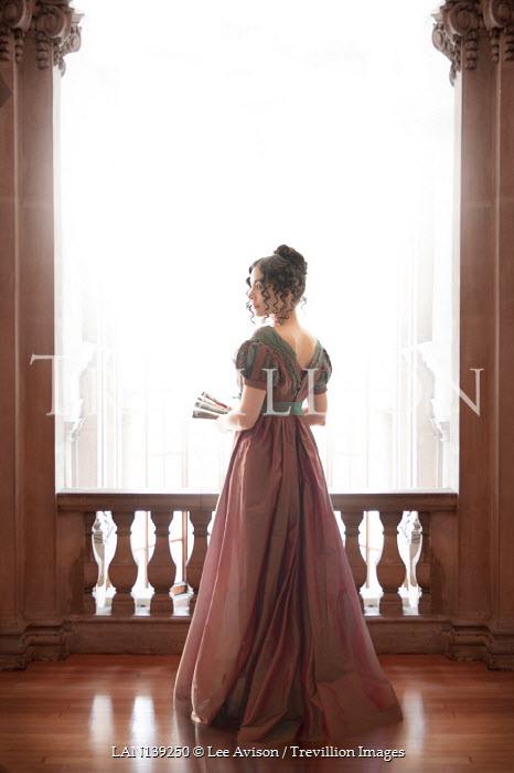 Lee Avison beautiful brunette regency woman by the balustrade