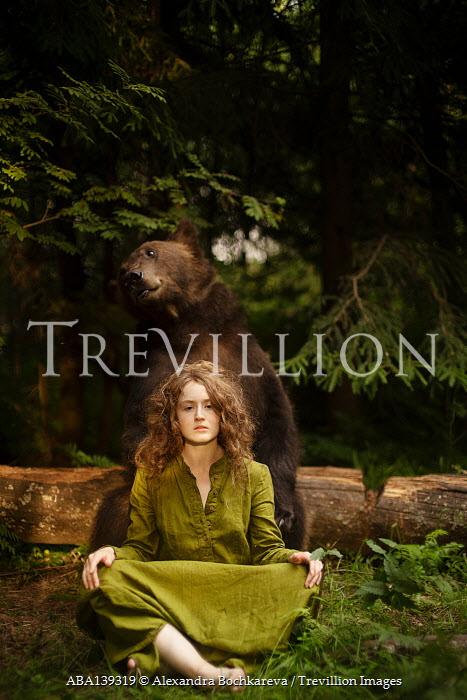 Alexandra Bochkareva WOMAN AND BEAR SITTING IN FOREST
