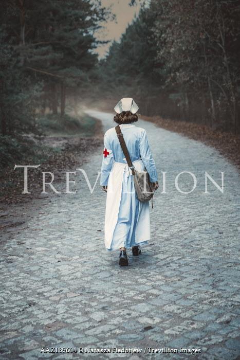 Natasza Fiedotjew vintage nurse walking away on cobbled pavement