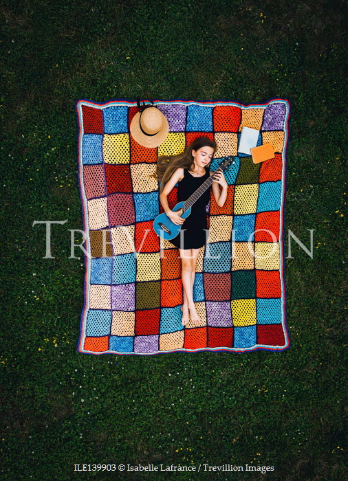 Isabelle Lafrance GIRL LYING ON BLANKET PLAYING GUITAR