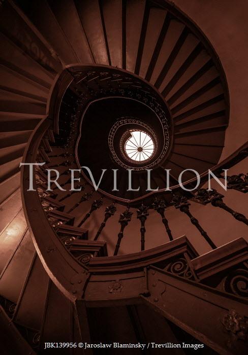 Jaroslaw Blaminsky SPIRAL STAIRCASE IN SHADOW FROM BELOW