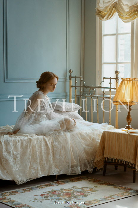 Natasha Yankelevich SAD WOMAN IN WHITE SITTING ON BED
