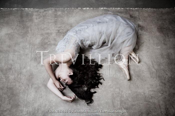 Robin Macmillan FEMALE BALLET DANCER LYING ON FLOOR