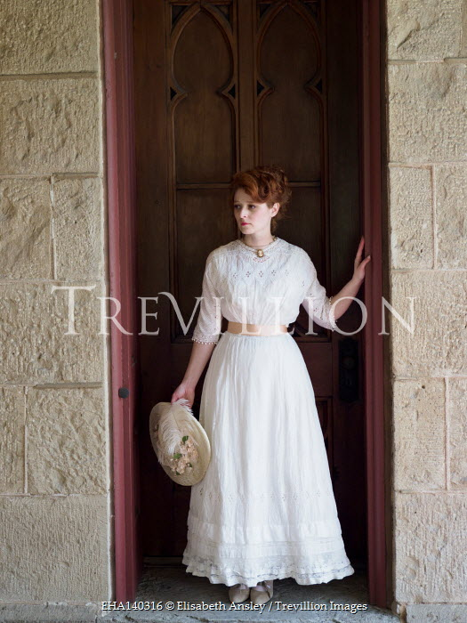 Elisabeth Ansley HISTORICAL WOMAN HOLDING HAT STANDING BY DOORWAY