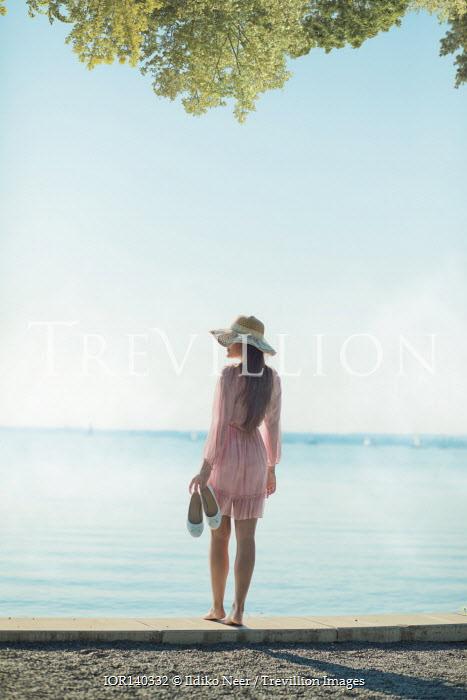 Ildiko Neer Young woman standing by sea
