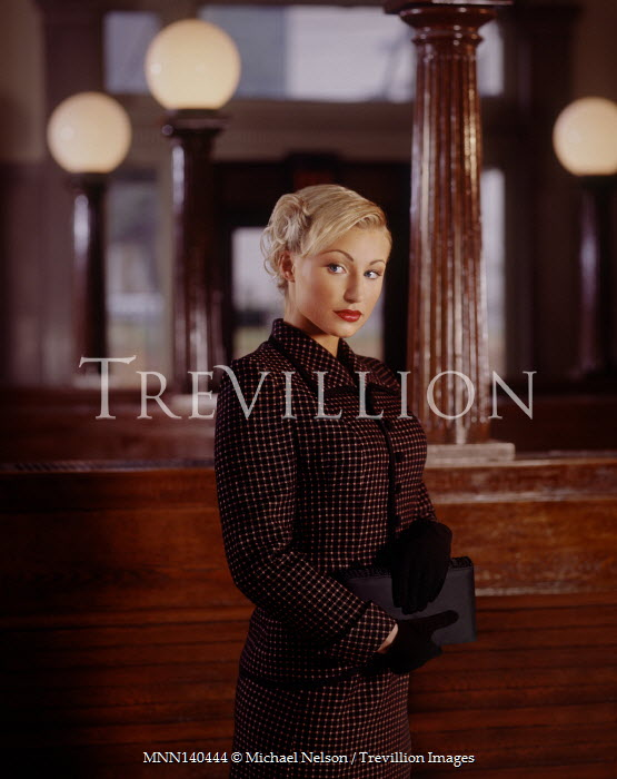Michael Nelson BLONDE RETRO WOMAN STANDING IN STATION