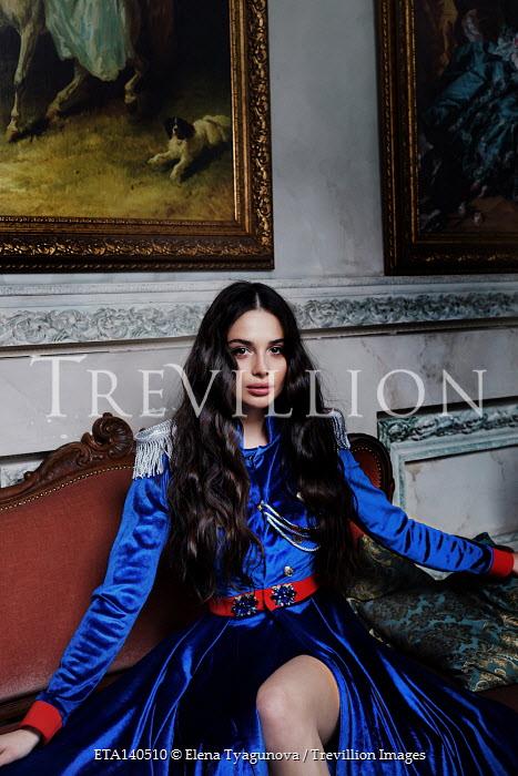 Elena Tyagunova WOMAN IN COSTUME SITTING BELOW PAINTINGS