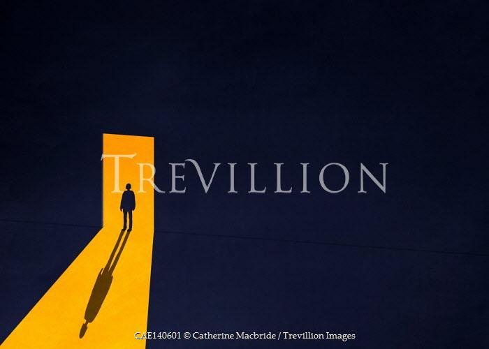 Catherine Macbride SILHOUETTED FIGURE STANDING IN LIGHT OF DOORWAY