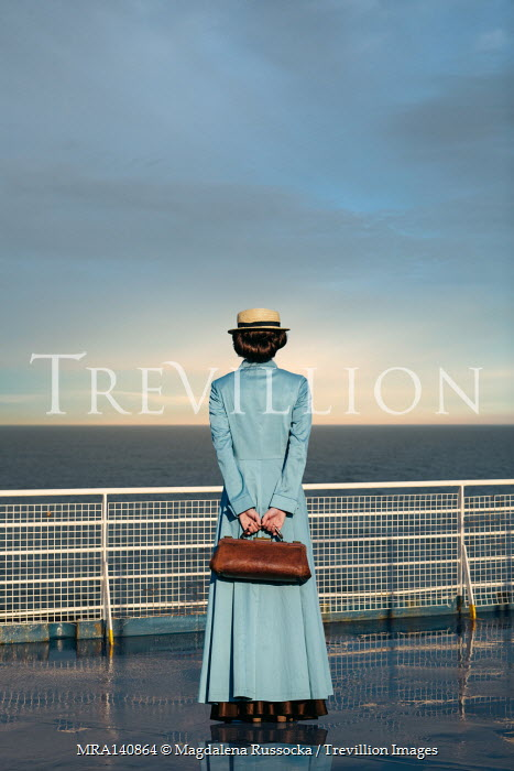 Magdalena Russocka historical woman standing on deck of ocean liner looking out to sea