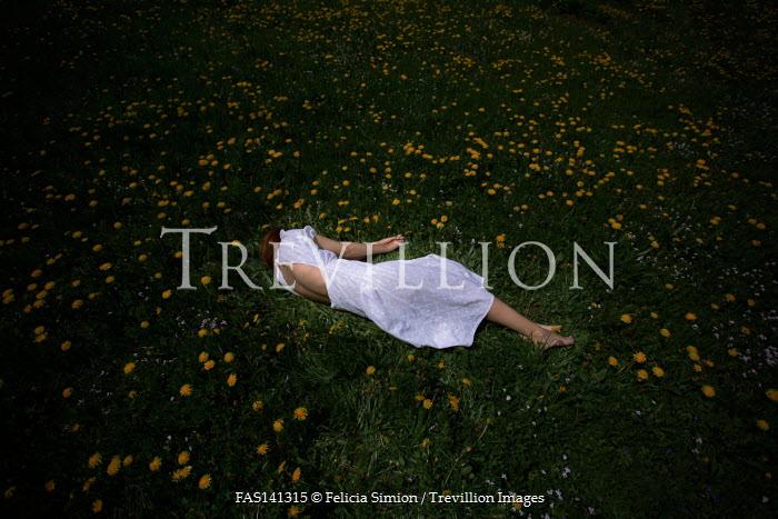 Felicia Simion WOMAN IN WHITE LYING IN DANDELION FIELD