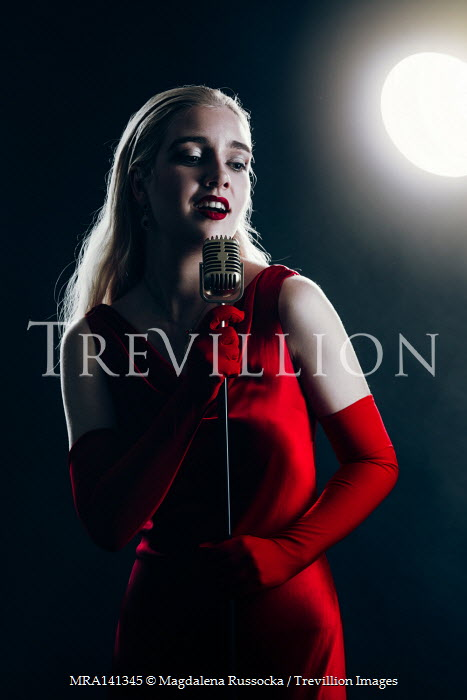 Magdalena Russocka retro woman wearing red dress singing on stage